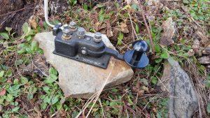 Navy Flameproof key sitting on stone.