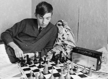 Photo of a young Anatoly Karpov, Soviet chess grandmaster, includes his multiband portable radio -- probably capable of receiving shortwave